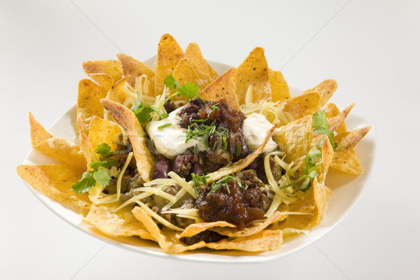 Smakelijk knapperig nachos geserveerd zure room restaurant Stockfoto © epstock