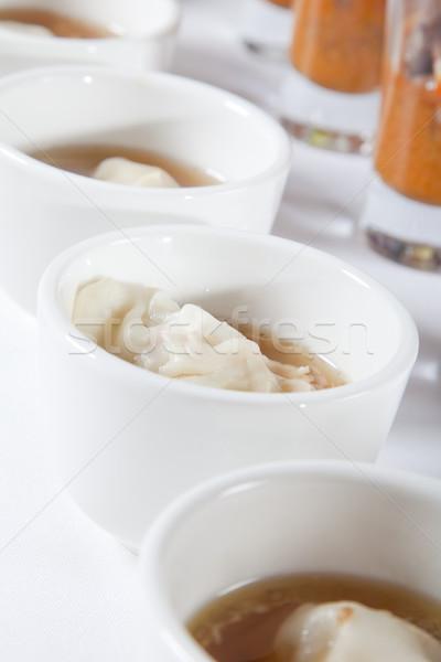Asian soup with dumpling Stock photo © epstock