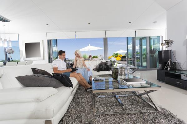 Couple in living room Stock photo © epstock