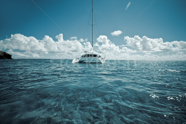 Katamaran on calm green shallow waters Stock photo © epstock