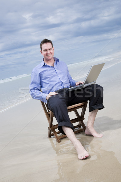 Stockfoto: Zakenman · vergadering · stoel · strand · laptop · business