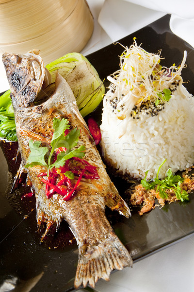 Australian Barramundi, served with fragrant Jasmine rice and wil Stock photo © epstock