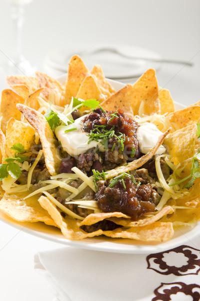 Smakelijk knapperig nachos restaurant kaas vlees Stockfoto © epstock