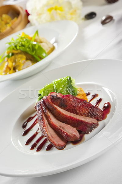 Oven crisp duck breast marinated in a Peking duck style sauce on Stock photo © epstock