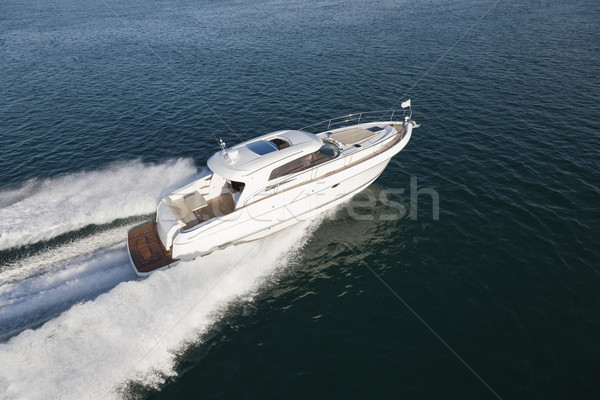 Beautiful yacht flying over the surface of the ocean Stock photo © epstock