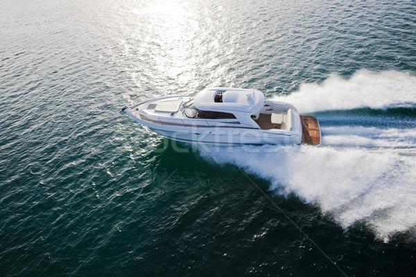 Luxurious boat racing through the ocean Stock photo © epstock