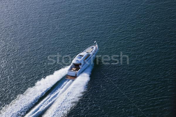 Beautiful speed boat sailing through the sea Stock photo © epstock