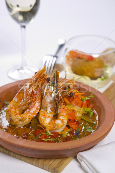 sizzling prawns with condiments and wine Stock photo © epstock