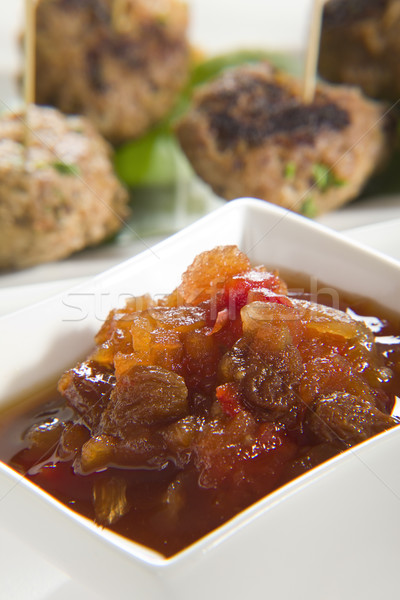 Chutney with meatballs in background Stock photo © epstock