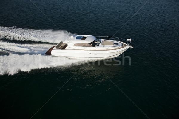 A fast motor boat sailing through the sea Stock photo © epstock