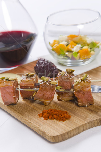 Beef served on skewers with condiments and red wine Stock photo © epstock