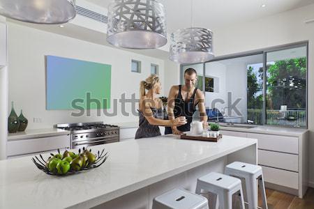 Jeune femme salle à manger luxe appartement femme Photo stock © epstock