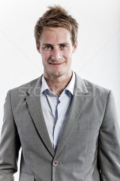 business man in grey suit on white background in studio Stock photo © epstock
