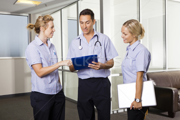 Stock photo: Young doctor with two nurses
