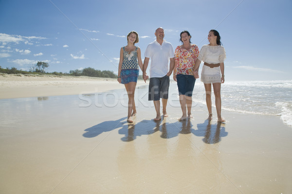 family walking on beach holding hands Stock photo © epstock