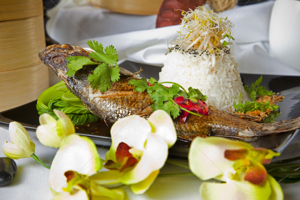 Australian Barramundi, served with fragrant Jasmine rice and wil Stock photo © epstock