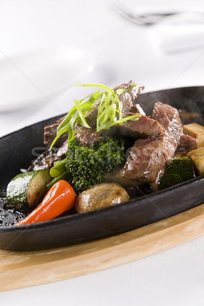 Honey & Pepper Sizzling Beef and vegetables Stock photo © epstock