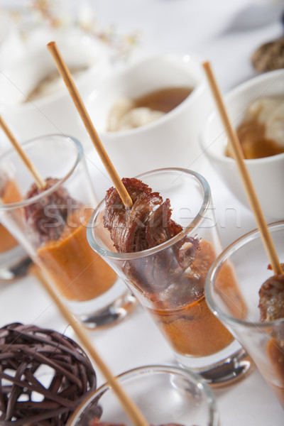 Asian Fusion lamb on stick in shot glass with sauce Stock photo © epstock
