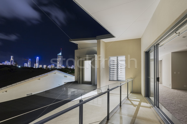 Balcony exterior of mansion with night views of skyline Stock photo © epstock