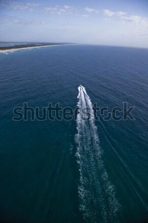 Mały motorówka żeglarstwo wyspa horyzoncie wody Zdjęcia stock © epstock