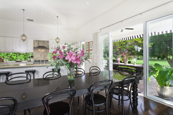 Dining area and kitchen overlooking a golf course Stock photo © epstock