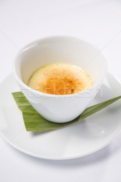 Creme Brulee served in white bowl Stock photo © epstock