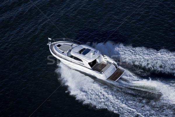 Elegant speed boat sailing in the sea Stock photo © epstock