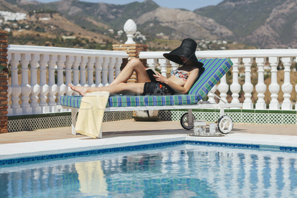 young girl reading by the pool Stock photo © epstock