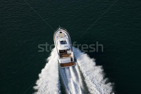 Elegant yacht sailing though deep waters Stock photo © epstock