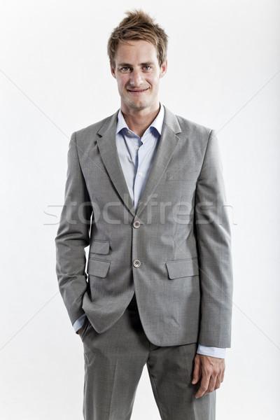 üzletember szürke öltöny fehér stúdió üzlet Stock fotó © epstock
