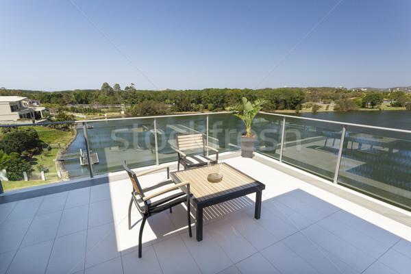Сток-фото: небольшой · балкона · здании · домой · таблице · синий