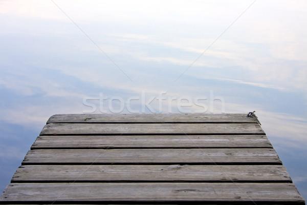 Einde pier wolken meer houten schoonheid Stockfoto © erbephoto