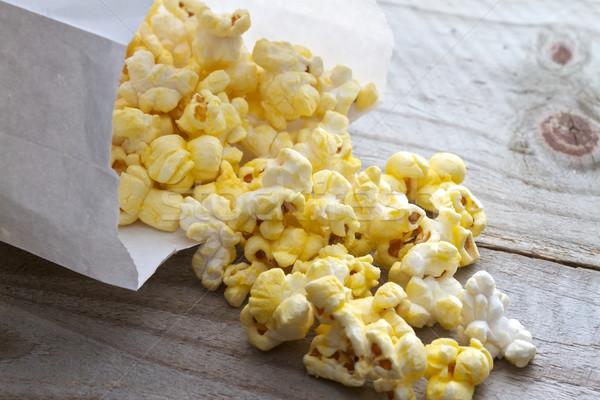 Popcorn witte zak picknicktafel voedsel eten Stockfoto © erbephoto