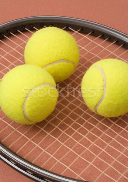 Tennis balls and racket Stock photo © ErickN