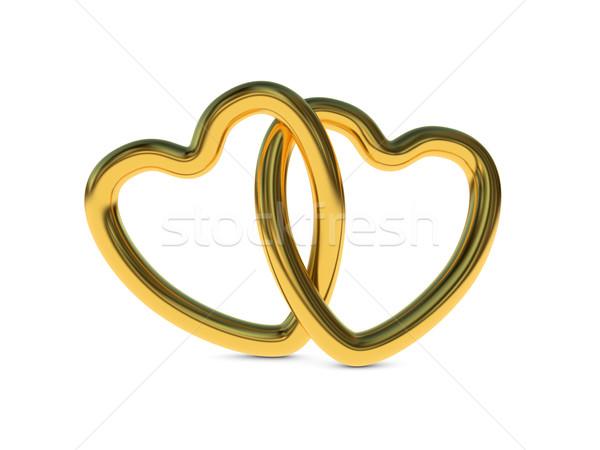 Intertwined gold heart rings Stock photo © ErickN