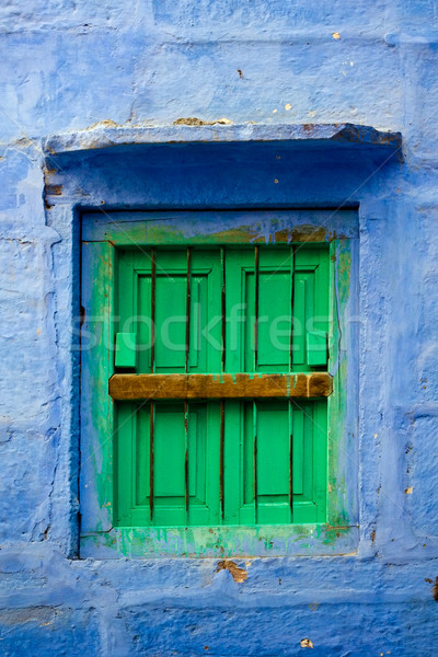 Blue wall and green shutters Stock photo © ErickN