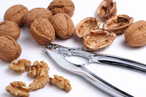 Walnuts and a nutcracker Stock photo © ErickN
