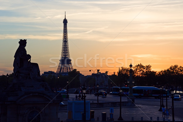 Coucher du soleil Tour Eiffel silhouette Paris France nuages Photo stock © ErickN