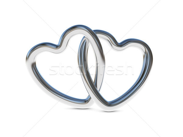 Stock photo: Intertwined silver heart rings