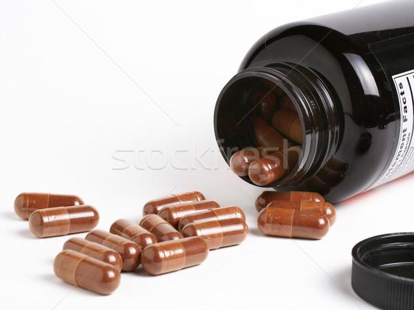 Diétás kiegészítők folyik egészség üveg erő Stock fotó © ErickN