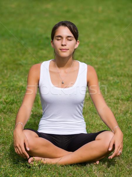 Joli jeune femme méditer herbe femme fille Photo stock © ErickN