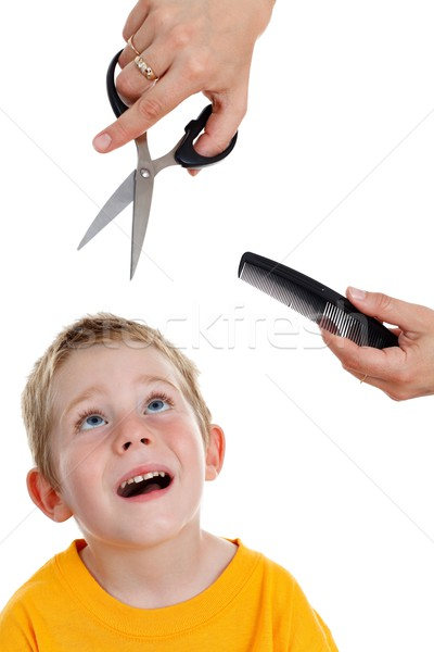 Scared little boy looking up to scissor and comb Stock photo © erierika