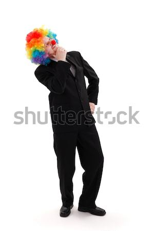 Iş adamı renkli palyaço peruk düşünme Stok fotoğraf © erierika
