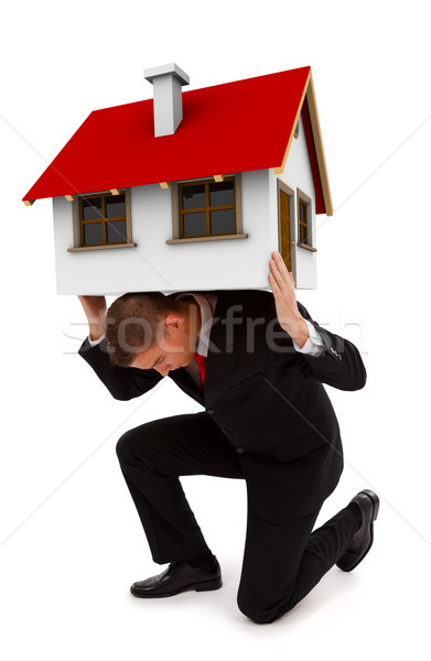 Business man holding house on his back Stock photo © erierika