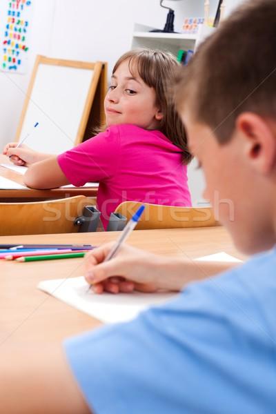 Iskolás lány néz kollégák teszt hát gyermek Stock fotó © erierika
