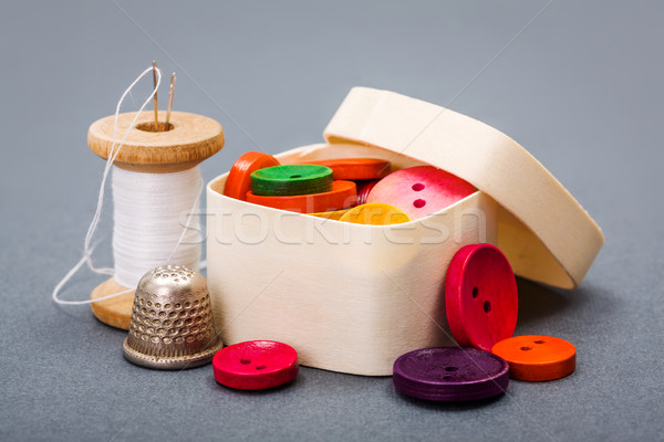 Colorful buttons in wooden box  Stock photo © erierika