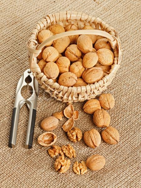 Walnut in basket and nut cracker Stock photo © erierika