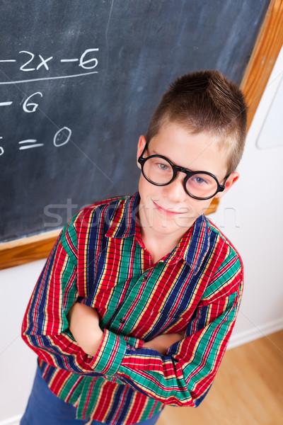 Smart schoolboy at chalkboard Stock photo © erierika