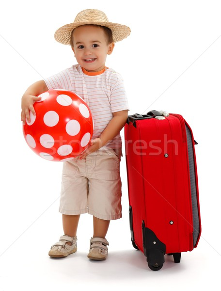 Kid with red ball and suitcase, ready for journey Stock photo © erierika