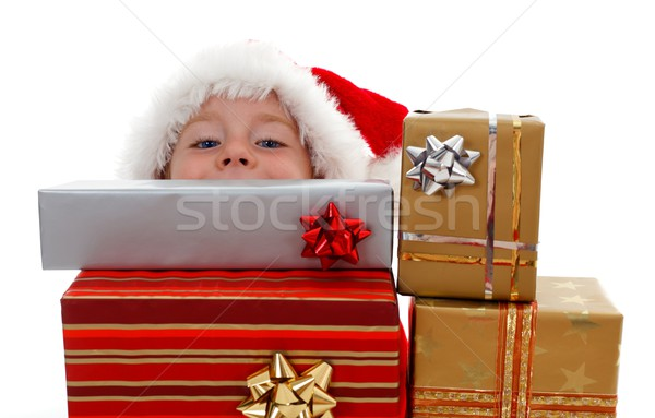 Young boy peeking above gifts Stock photo © erierika
